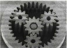 Рис. 4. Планетарный редуктор с миниатюрными шестернями из металла. Диаметр редуктора около 1,5 мм